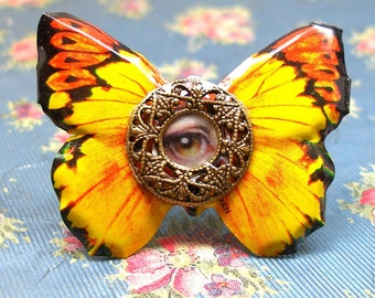 Soaring Lover's Eye ring, Vintage lithographed BUTTERFLY with golden eye on adjustable ring.