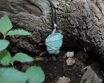 Turquoise wrapped in Sterling Silver