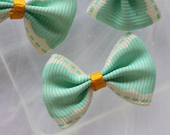 Pretty light blue dotted ribbon bow