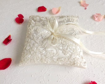 Ivory Wedding Ring Pillow. Satin ring bearer decorated with embroidered floral lace.