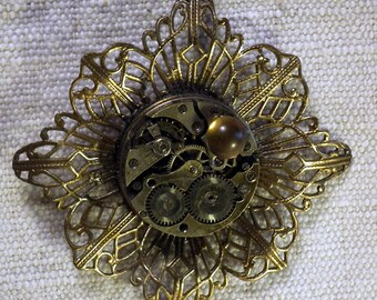 Steampunk  pendant, bronze colour filigree stamping,,  watch mecanism,  glass cab