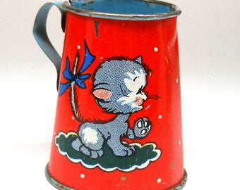 50s Tin Toy tea pitcher, Kitty graphics by Ohio Art.