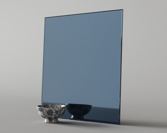 Blue Mirror Swatch by Mirror Coop. Custom blue mirror that can be used in furniture and other design projects made in our California studio
