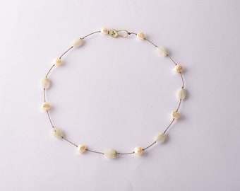 Moonstones and pearls on a string