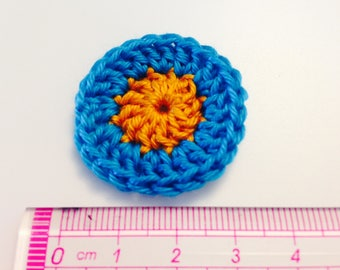 "Orange and turquoise rosette ""Giraffe"" crochet flower"