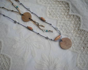Long necklace with pendant beads and Holly