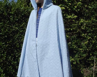 Blue lined cape for a child with hood with wonderful swirl pattern