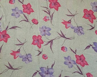 Green animal print rayon with pink and purple flowers