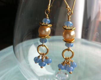 Earrings with a bunch of blue Czech glass beads hanging from a white Swarovski pearl