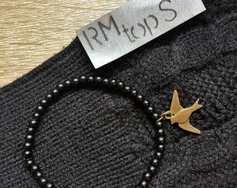 Bracelet beads matte black with brass charm swallow minimalist bracelet beads matte black with brass swallow charm mini Mali
