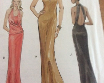 VOGUE PATTERN. Sizes 8-10-12.  Uncutand factory folded.  Misses evening dress with train..invisible zipper closing.  Two styles.