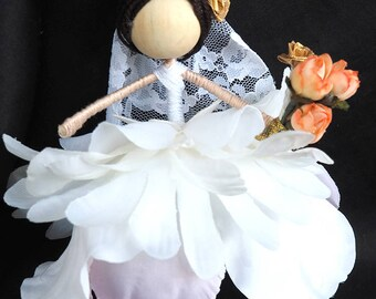Flower fairy doll. Beautiful little dark haired bride.