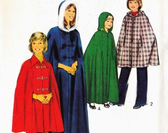 Sewing pattern Style 4879 Lined cape in two lengths with collar or hood and frog fastening open end zipper Size 4 6 8 10 12 uncut