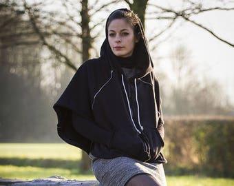 The black hooded Cape inside the power of sportswear.