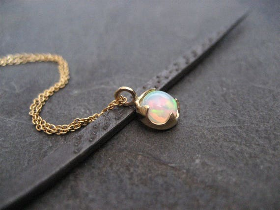 Opal necklace 14k gold ethiopian opal pendant welo opal like this item mozeypictures Gallery