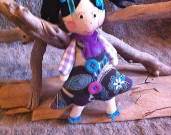 Purple cloth doll with tulle scarf