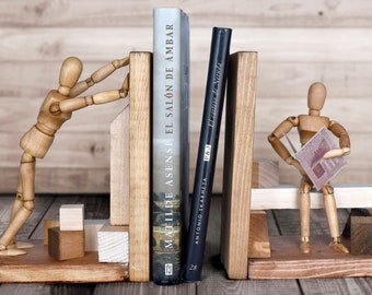 2 wooden bookends with puppets