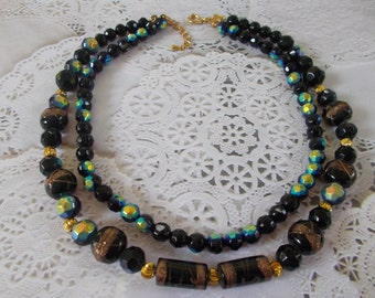 Vintage Black Faceted Two Strand Round and Barrel Beaded Glass Necklace Aurora Borealis Coloring Gold Tone Findings
