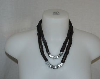 Double necklace made of brown leather chocolate, nuts, metal silver