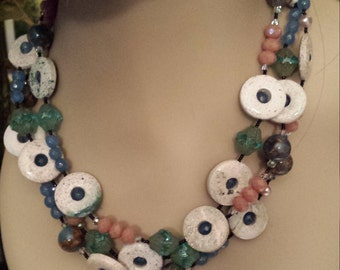 Three strand necklace made with off white candy jaspers and other assorted beads