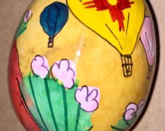 Hot Air balloon with zia Christmas Ornament by Sandy Short hand painted on a wild buffalo gourd.  handpaintedgourds.com