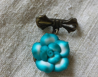 small blue and white flower brooch