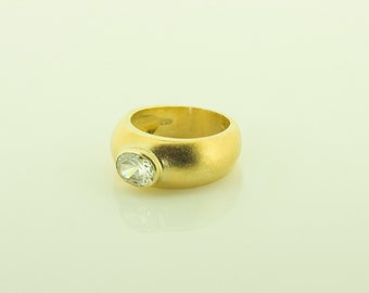 Hallmarked Sterling Silver gold plated ring set with an oval cubic zirconia