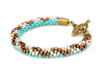 Beaded kumihimo bracelet - matte turquoise, bronze and cream with toggle clasp
