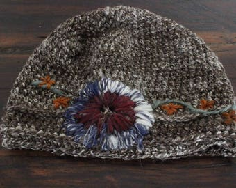 Crocheted hat, made from handspun yarn with wool embroidery