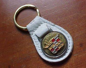 1950s CADILLAC CREST Brass Logo On White Leather Key Fob Retro Detroit Chic Rare Industrial Mo-Town Swag Accessory Coupe De Ville Eldorado