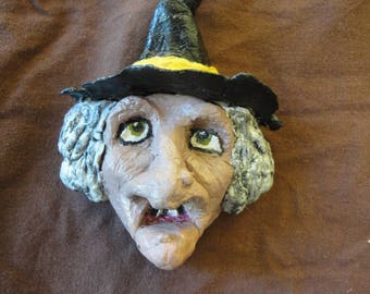 Surprised witch paper mache magnet