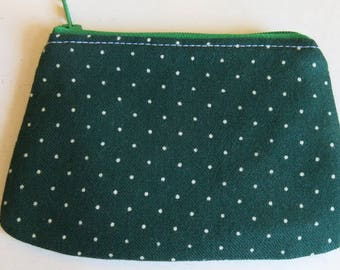 Coin purse in dark green spotty print.