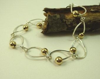 sterling silver tear drop bracelet with 14 kt. gold filled beads