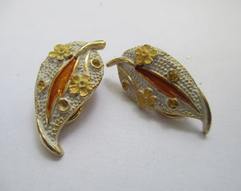 Vintage signed BSK enameled leaf clip on earrings with yellow glass faceted crystals used