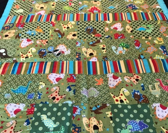 Dinosaur baby crib quilt.