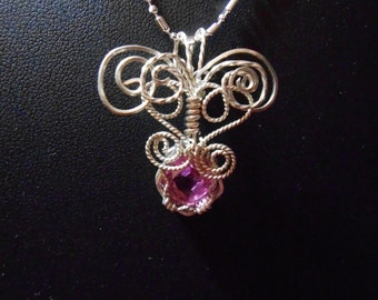 Pink Chatham sapphire wrapped in Argentium silver.