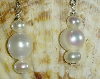 Three genuine pearls make a sophisticated statement in these elegant drop earrings