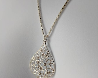 Silver Flowers Teardrop Pendant Necklace on a delicate silver chain