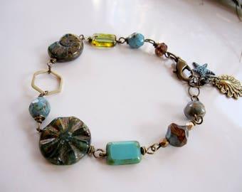 Bohemian Beach Bracelet, Vintage Style, Brass Shell charm, blue Beads, Rustic, natural Elements, Blueartichokedesigns
