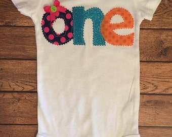 "Bright Pink, Purple, Turquoise, Orange, and Lime Green 1st Birthday ""One"" Shirt or Baby Bodysuit"