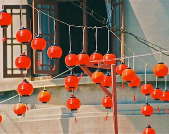 Photograph:  red  turquoise Chinese New Year lanterns photograph Chinatown Asia hanging celebratory lanterns abstract