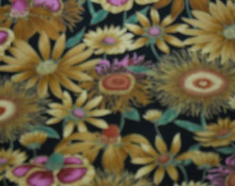 Prairie Flowers in Gold Tan And Brown on a Black Back Ground