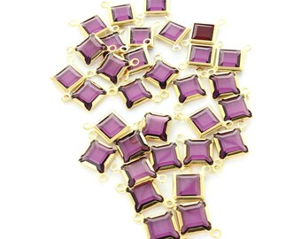 Swarovski 8mm amethyst square channels with 2 loops.  Gold plated.  Price is for 1 lot of 33 pieces