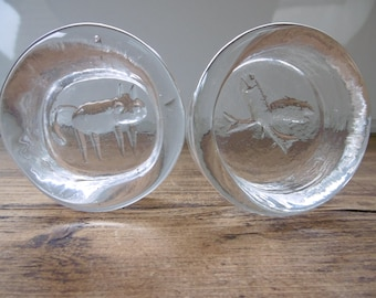 A pair of Kosta Boda- Swedish clear glass bowls designed in the1960s by Erik Höglund