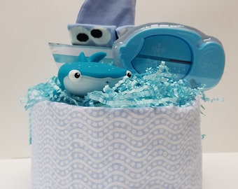 Cake layers + gifts, baby shower gift baby