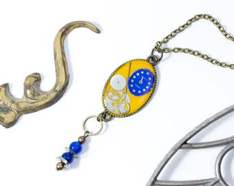 """Yellow mustard and blue """"oldies"""" pendant with watch parts and vintage touch"""