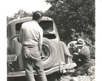 """Vintage Snapshot """"Road Service"""" Changing A Flat Tire Oregon License Plate Back To Camera Faceless 1938 Found Vernacular Photo"""