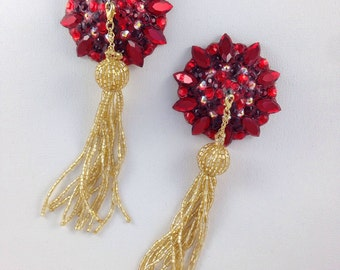 Ruby red pasties with gold tassel