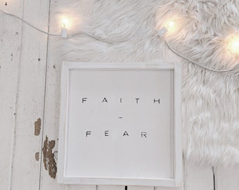 faith over fear black and white wooden sign