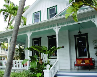 Key West, Florida Vintage Home with Wrap Around Porch and Red Seat